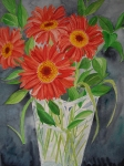 Red Daisies in Clear Vase